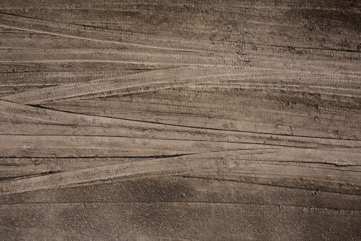 Tire tracks in the soil.