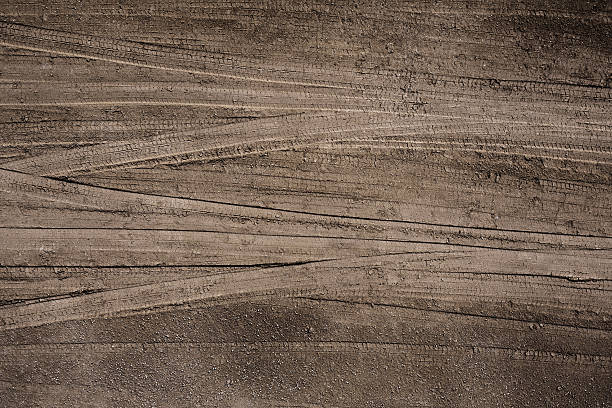 Tire Tracks Tire tracks in the soil. tire track stock pictures, royalty-free photos & images