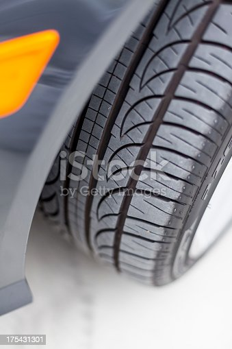 Close-up of tire on car.