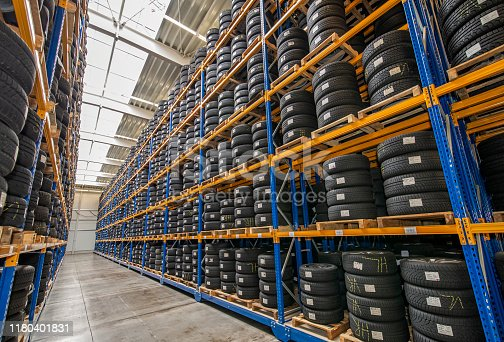 High rack with customer tires in warehouse of a tire dealer