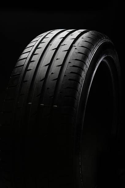 a tire with new black background - wheel black background bildbanksfoton och bilder