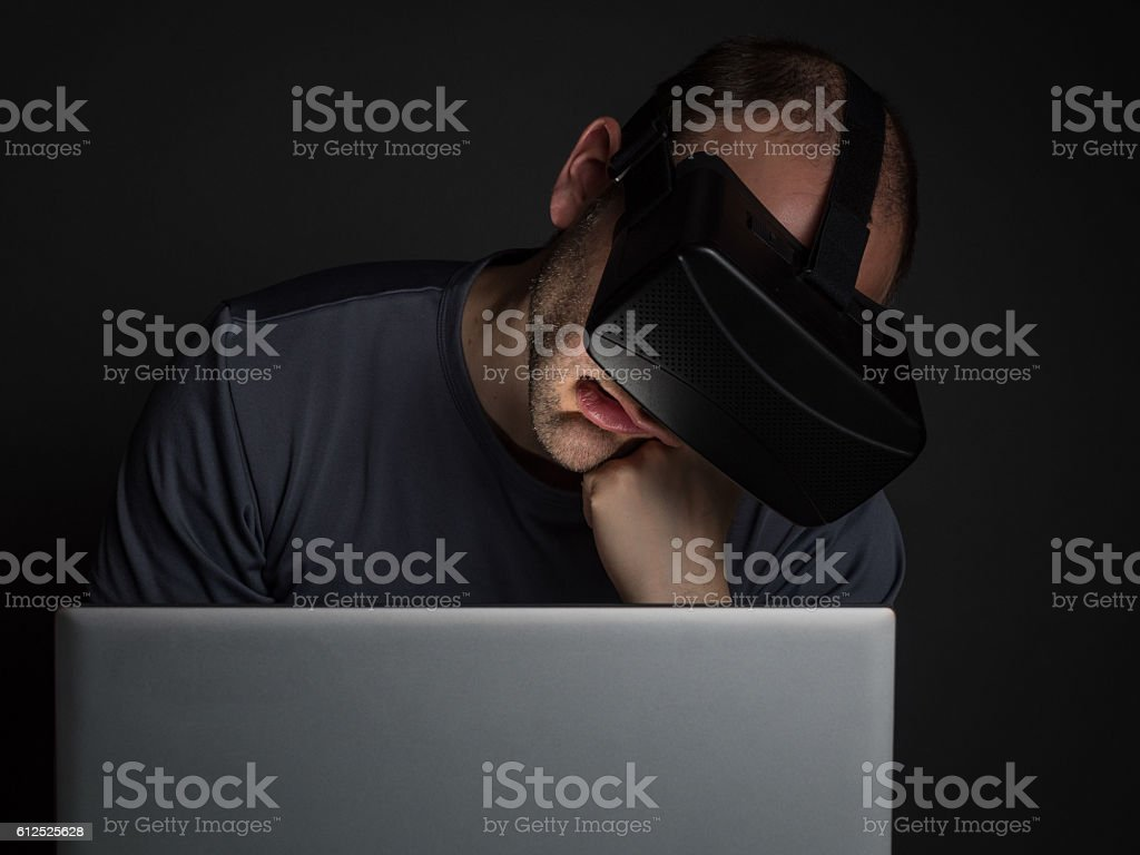 Tired addicted man to technology  using virtual reality stock photo