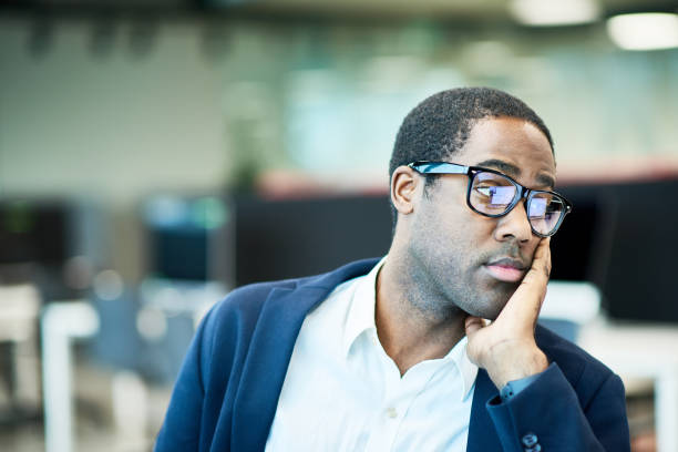tired african manager at work - tedious stock photos and pictures