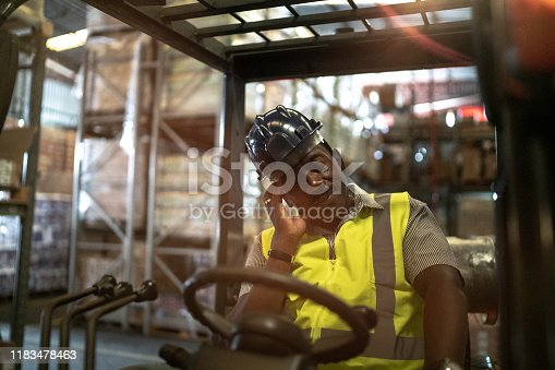 Tired African mature forklift driver man
