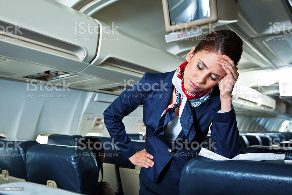 Tired air stewardess stock photo