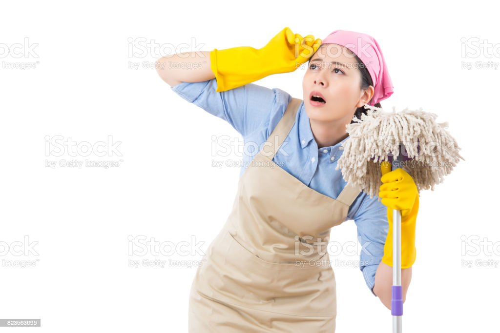 Tired and exhausted cleaning woman stock photo