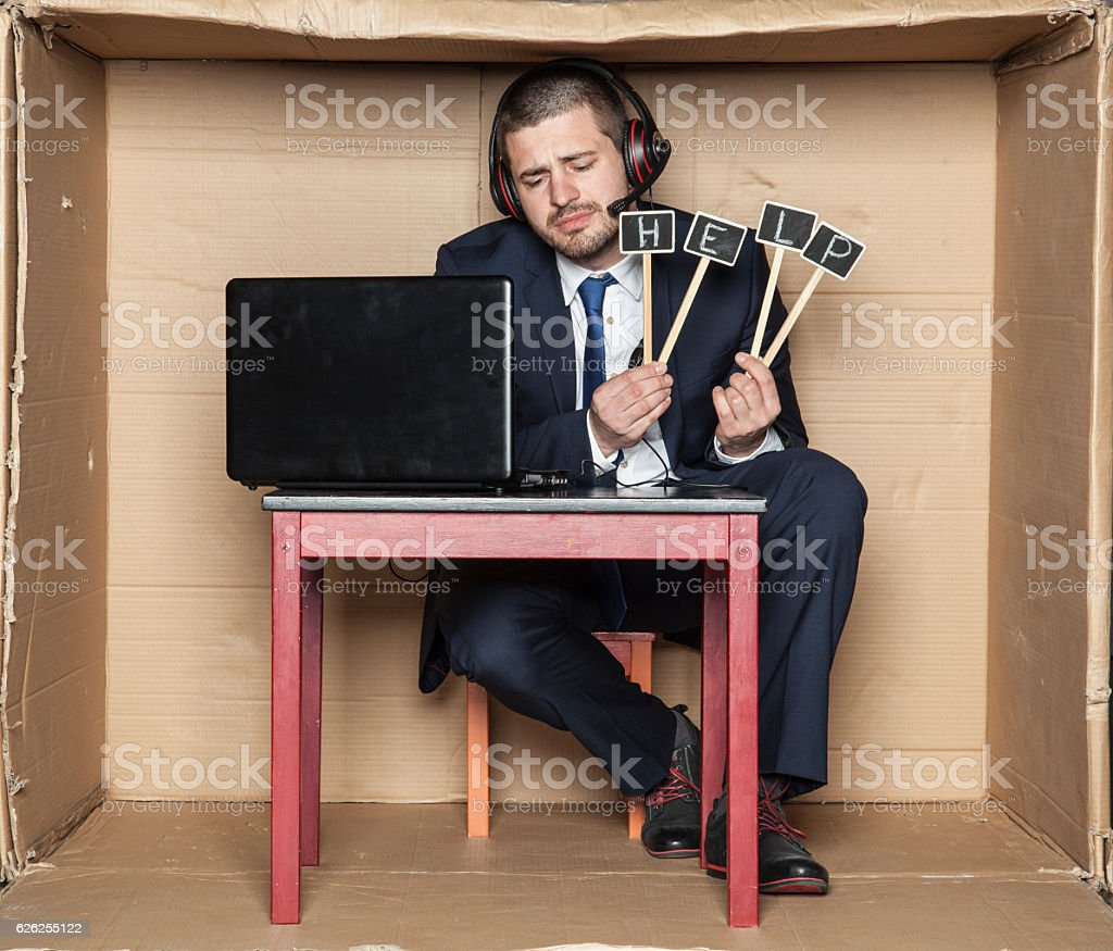 tired and exhausted worker asks for help stock photo