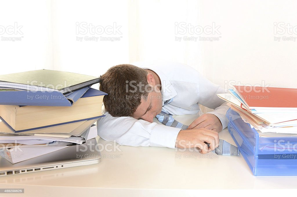 Tired and Overworked Businessman or Student sleeping stock photo
