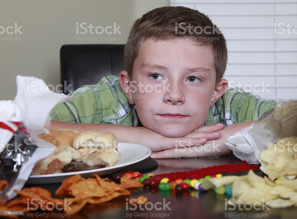 Tired and Sad after Eating Junk Food royalty-free stock photo