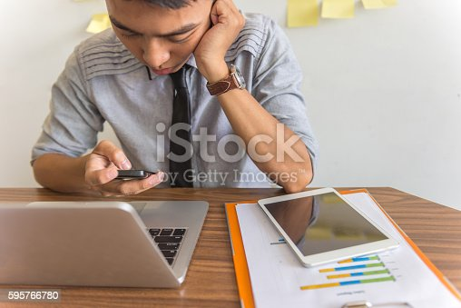 Tired and stressful man overloaded with big amount of work
