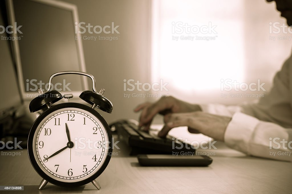 Tired asian businessman work overtime stock photo