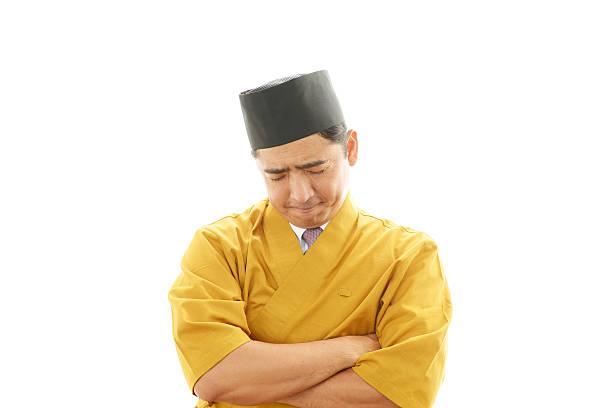 stanco asiatica cook - chef triste foto e immagini stock
