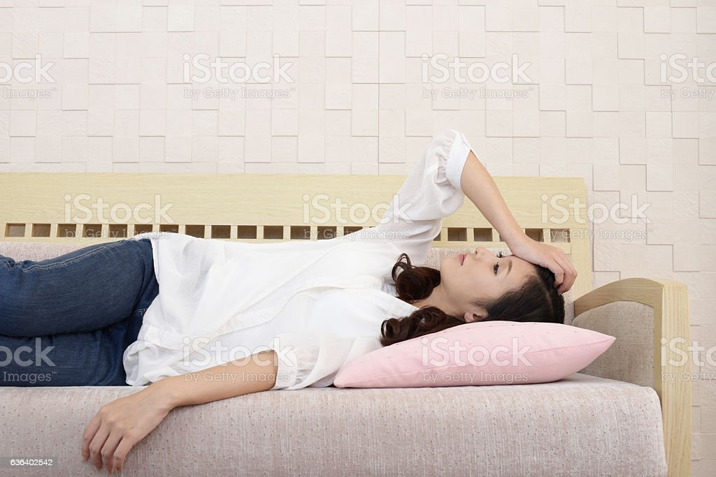 Tired Asian woman stock photo