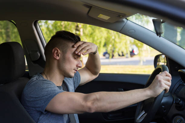 tired at the wheel. - impaired driving stock photos and pictures