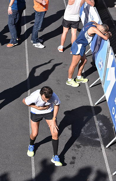 Tired athletes after the finish during the 2016 Athens Marathon stock photo