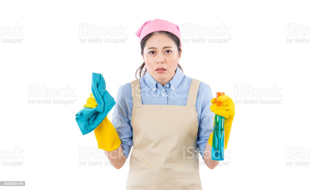 Tired attractive young woman in yellow gloves stock photo