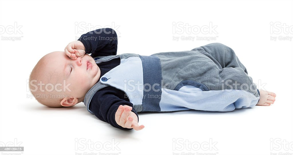 tired baby on floor isolated on white stock photo
