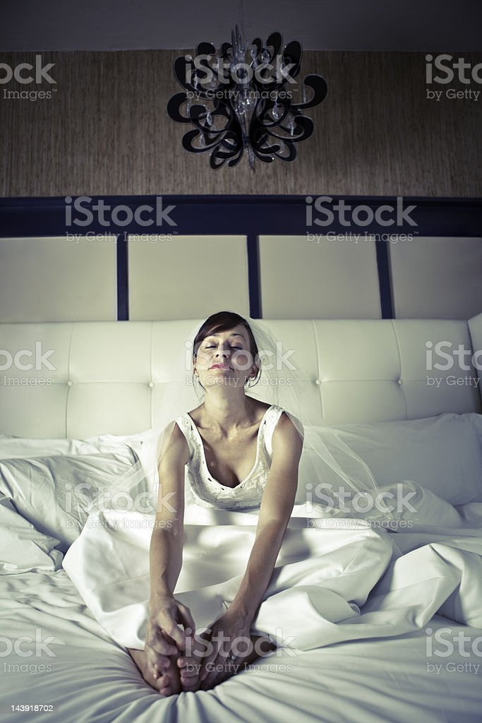 Tired Bride Sitting on Bed royalty-free stock photo