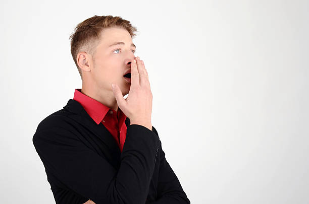 Tired business looking surprised and amazed. Man yawning. stock photo