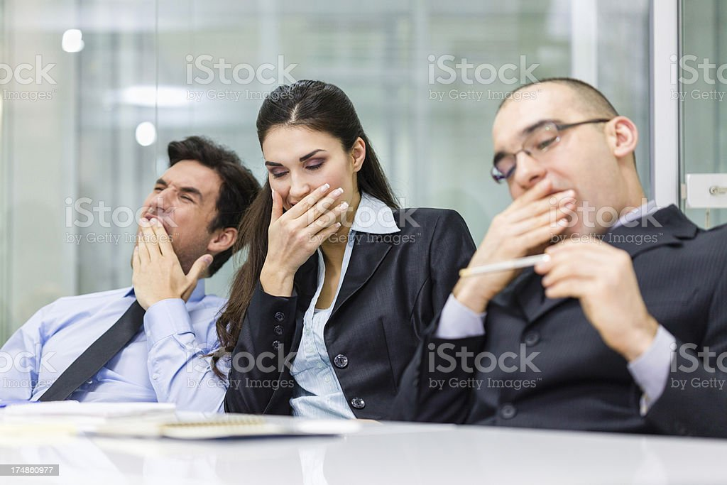 Tired business people yawn stock photo