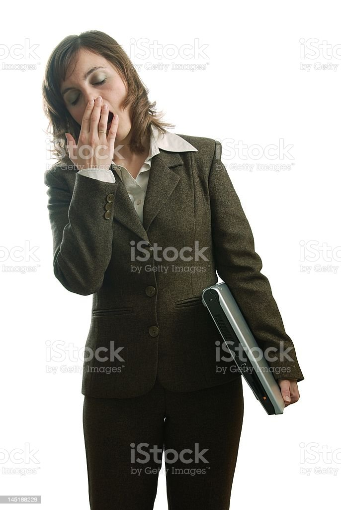 Tired business woman in suit with computer royalty-free stock photo
