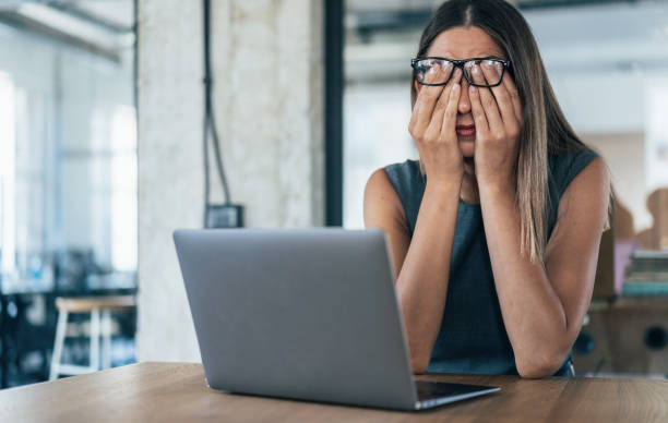 Tired Business woman Business woman with hands on her face looking exhausted head in hands stock pictures, royalty-free photos & images