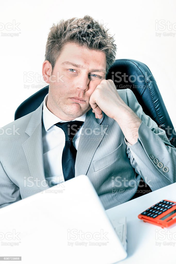tired businessman at the office stock photo