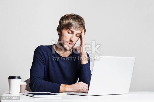istock Tired businessman having headache at work 626773884