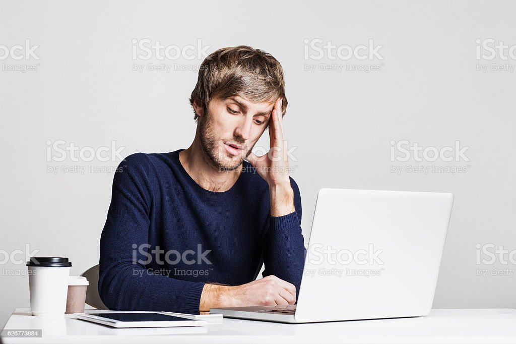 Tired businessman having headache at work stock photo