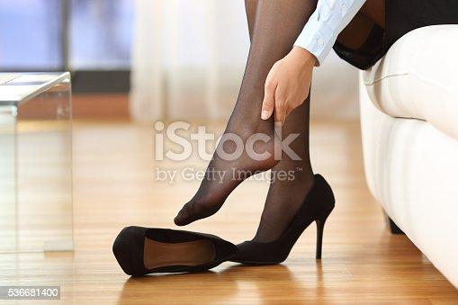 istock Tired businesswoman feet pain 536681400