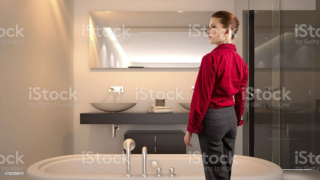 Tired Businesswoman getting ready to take a bath stock photo