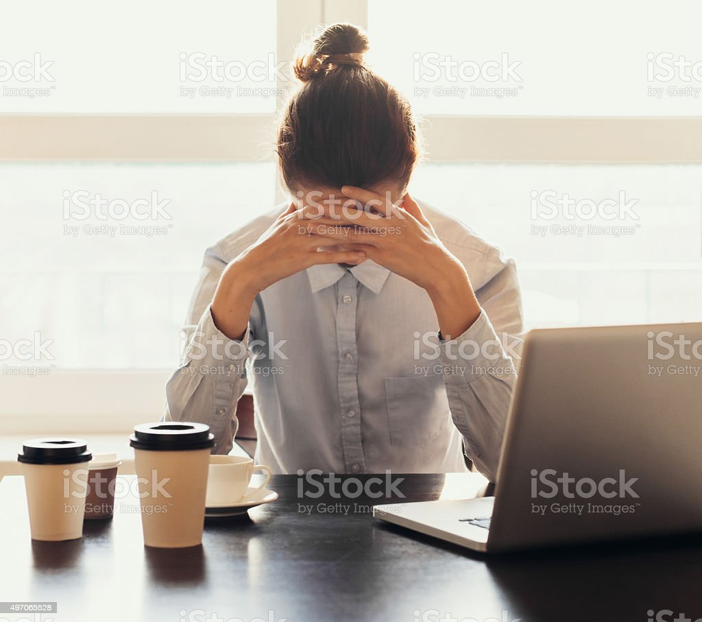 Tired businesswoman in the office stock photo