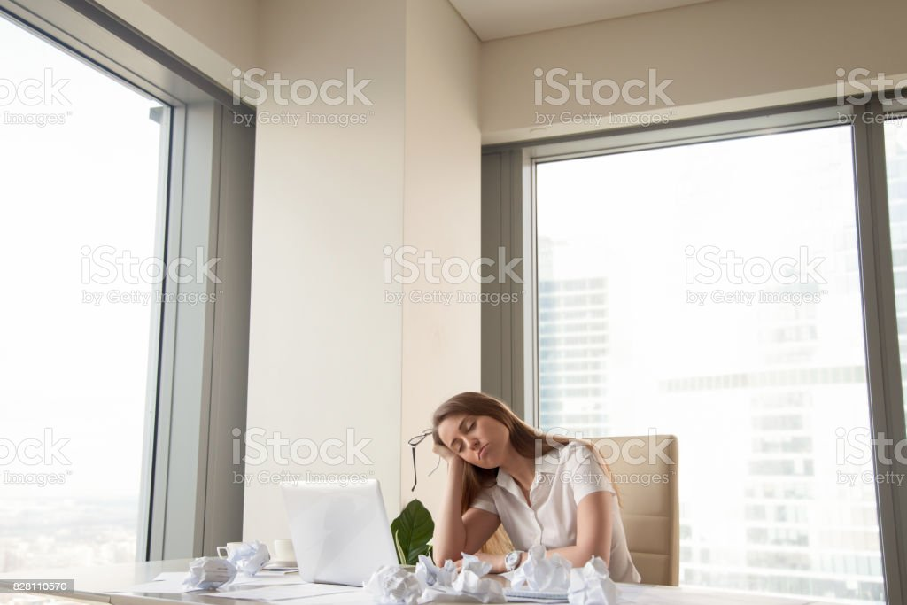 Tired businesswoman unproductive to finish urgent work, too much paperwork stock photo