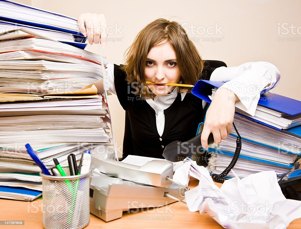 Tired businesswoman with telephones royalty-free stock photo