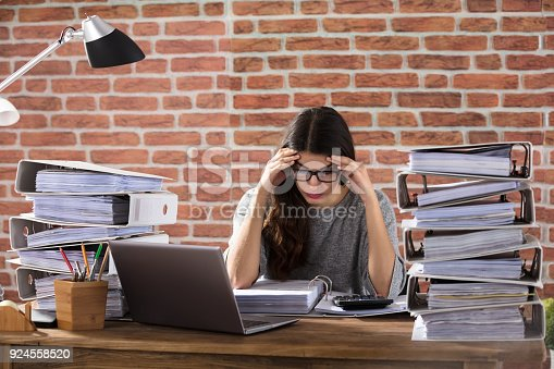 istock Tired Businesswoman Working At Office 924558520
