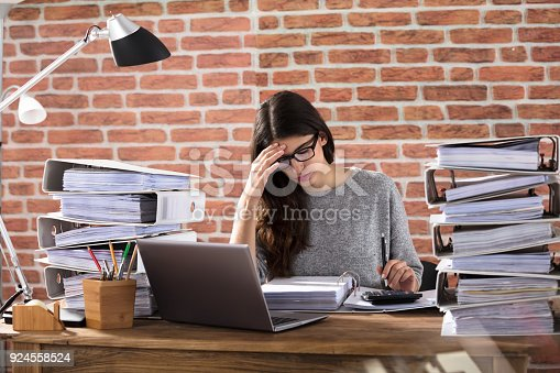 istock Tired Businesswoman Working At Office 924558524