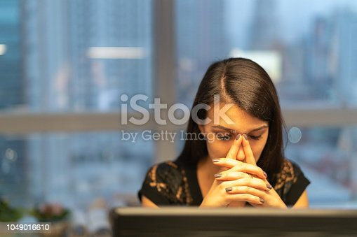 istock Tired Businesswoman Working Late at Office 1049016610