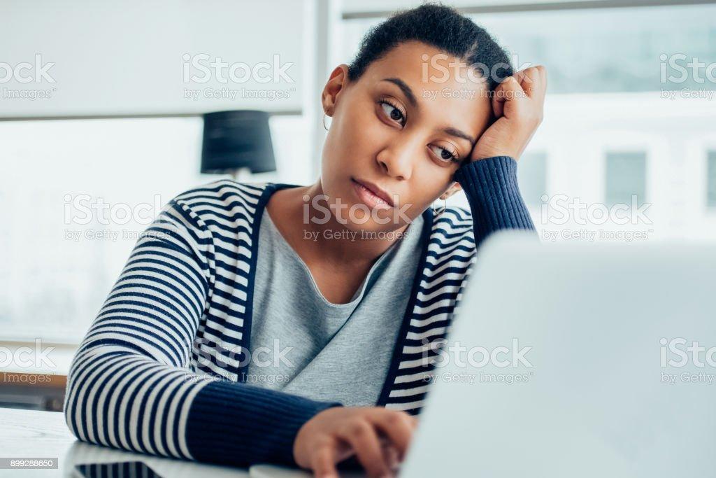 Tired businesswoman working on laptop_tone stock photo