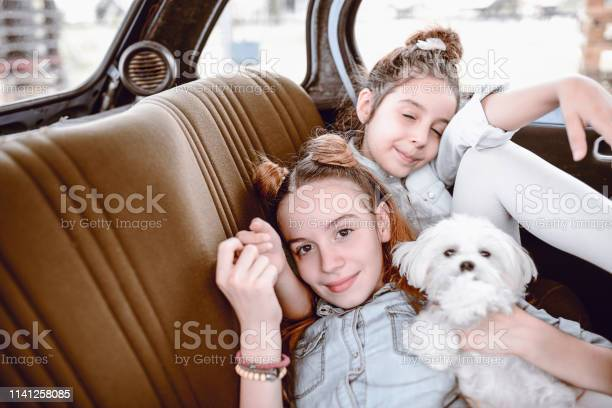 Tired children resting on car backseat picture id1141258085?b=1&k=6&m=1141258085&s=612x612&h=vzqc2uslu5ax2yscbf7ows en6h74b2rhtqtehv9uea=