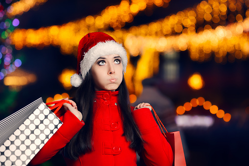 Tired Christmas Woman With Shopping Bags
