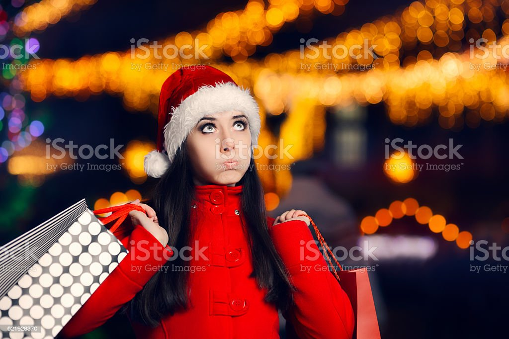 Tired Christmas Woman With Shopping Bags stock photo