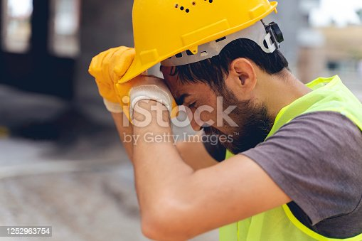 USA, Sydney, Construction Worker, Sweat, Tired