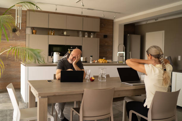 tired couple working from home during covid-19 quarantine stock photo