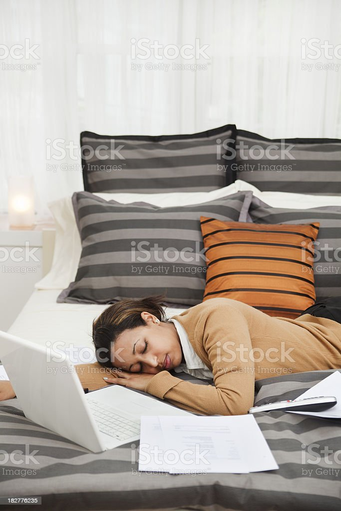 Tired Exhausted Business Traveler Working in Hotel Room Vt royalty-free stock photo