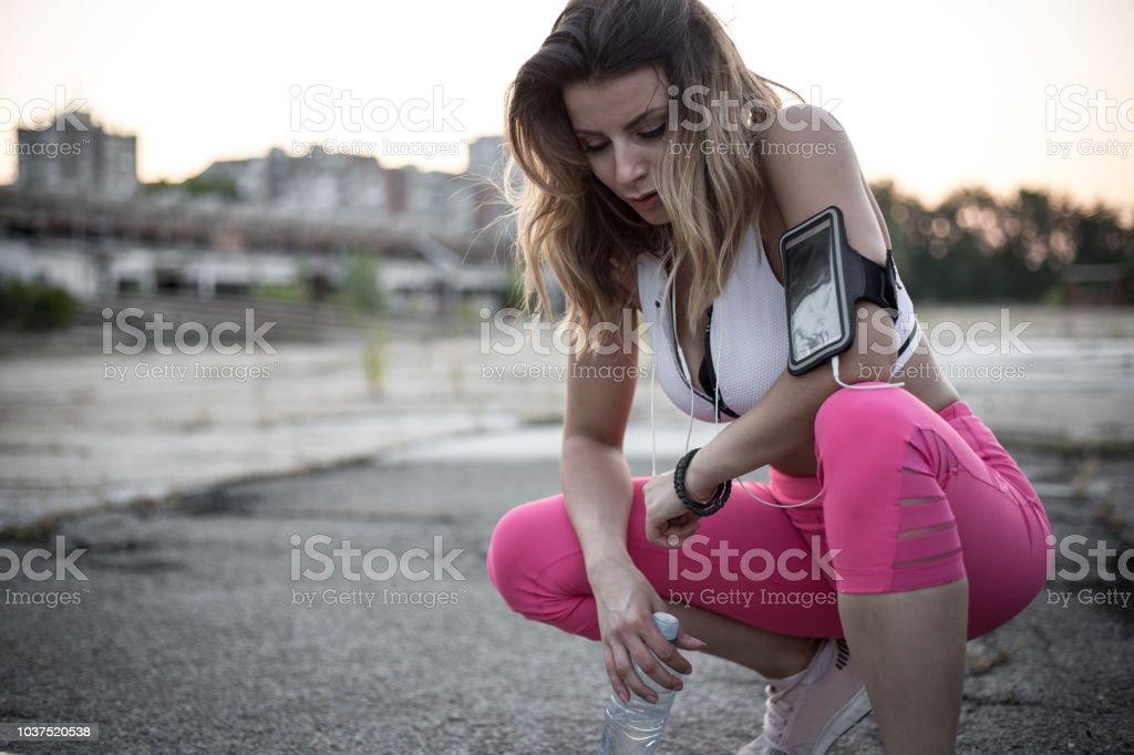 Tired female athlete after finished her training stock photo