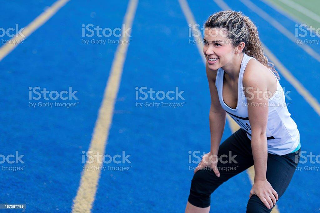 Tired female runner stock photo