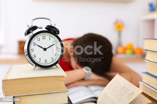 508126619istockphoto Tired female student at workplace in room taking nap 526842056