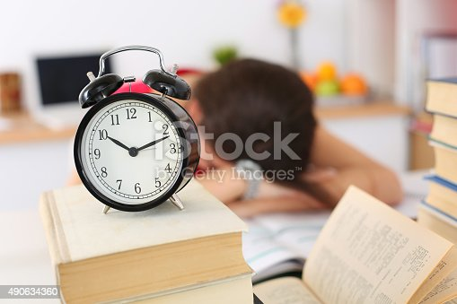 508126619istockphoto Tired female student at workplace 490634360