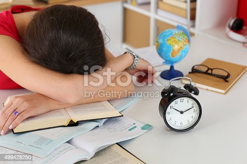 508126619istockphoto Tired female student at workplace 499428250