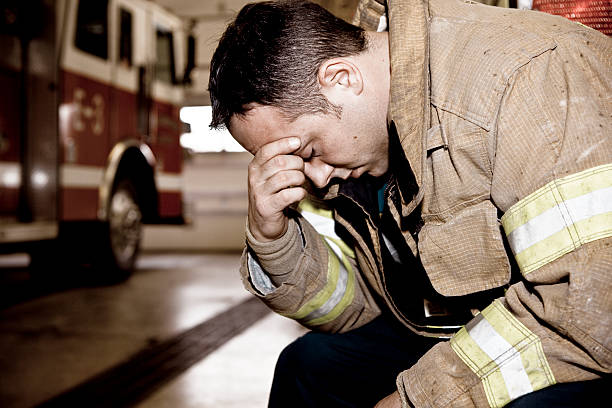 tired firefighter - man face down stock pictures, royalty-free photos & images